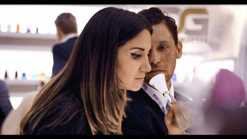 Young woman experiencing a fragrance with a cone CeraScent® in hand approaching her nose
